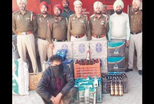 man-selling-illegal-liquor-on-his-fruit-shop