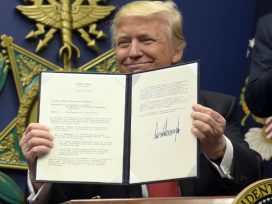 Donald Trump showing his signed order