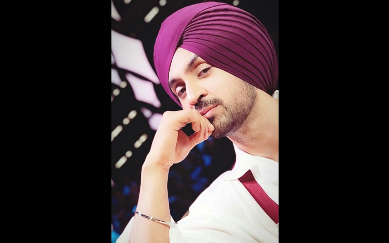 diljit-dosanjh-playing-tumbi